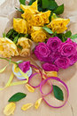 Fresh colorful roses yellow and pink on wooden table Stock Image