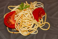 Fresh cooked spaghetti with tomatoes on black background Royalty Free Stock Image