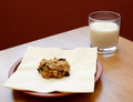Fresh cookie served with a glass of milk oatmeal raisin cold Stock Photography