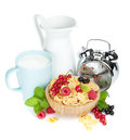 Fresh corn flakes with berries and milk Royalty Free Stock Photo