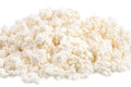 Fresh cottage cheese (curd) heap, isolated on white background . Royalty Free Stock Images