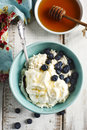 Fresh cottage cheese with sour cream and honey. Healthy breakfast Royalty Free Stock Photo