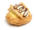 Fresh cream choux pastry bun isolated with custard and chocolate Stock Image