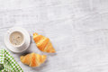 Fresh croissants and coffee Royalty Free Stock Photo