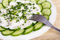Fresh cucumber slices with sour cream Royalty Free Stock Images