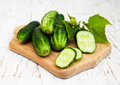 Fresh cucumbers on a old wooden background Royalty Free Stock Photography