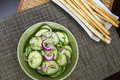 Fresh cucumbers salad and red onion detail Stock Image