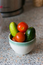Fresh cucumbers and tomatoes in a glass on the table bowl Stock Photo