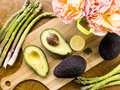 Fresh cut avocado with asparagus and lemon Royalty Free Stock Photo