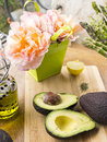Fresh cut avocado on the table olive oil lemon spicies and asparagus Stock Photo