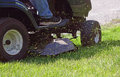 Fresh Cut Grass Flying From Riding Lawnmower Royalty Free Stock Photo