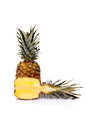 Fresh cut pineapple food fruits whole and in half on white background Royalty Free Stock Photo