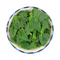 Fresh cut spinach leaves in bowl a top view of a of on white Stock Photo