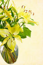 Fresh Cut Yellow Daylilies in a Transparent Water Filled Vase Royalty Free Stock Photo