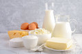 Fresh dairy products. Milk, cheese, brie, Camembert, butter, yogurt, cottage cheese and eggs on wooden table. Royalty Free Stock Photo