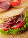Fresh deli sandwich with tomatoes, swiss chees Royalty Free Stock Images