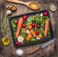 Fresh delicious ingredients for healthy cooking or salad making on rustic background, top view Diet or vegetarian food concept Royalty Free Stock Photo