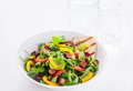 Fresh delicious rocket salad with bell pepper and tomato served grilled crispy flatbread for a healthy summer snack or Stock Images