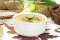 Fresh delicious sweet chestnut soup with chives on a light background Stock Photos