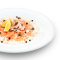 Fresh delishous salmon carpaccio served with parmesan cheese capers and lemon on white Stock Photos