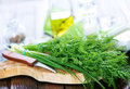 Fresh dill on board and on a table Stock Photos
