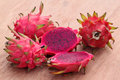 Fresh dragon fruits on wooden surface with selective focus Royalty Free Stock Images