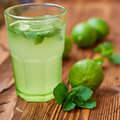 Fresh drink photo of home made limonade on wooden background