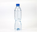 Fresh drink water bottle with small water condense drop inside b the head on white background Stock Photography