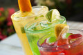 Fresh drinks on the green background Stock Photos