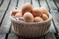 Fresh eggs in basket brown a wicker Royalty Free Stock Images