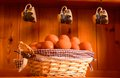 Fresh eggs in a basket pretty on kitchen dresser Stock Photo