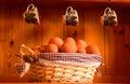 Fresh eggs in a basket pretty on kitchen dresser Stock Photo