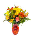 Fresh fall color flower arrangement in orange vase Royalty Free Stock Image