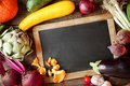 Fresh fall cooking ingredients around a slate Royalty Free Stock Photo
