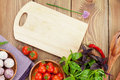 Fresh farmers tomatoes and basil on wood table Royalty Free Stock Photo