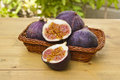 Fresh figs on a basket halved Royalty Free Stock Image