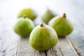 Fresh figs on vintage wooden background Royalty Free Stock Images