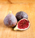Fresh figs on wooden background Stock Photos
