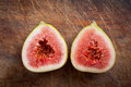 Fresh figs on the wooden table close up Stock Photo