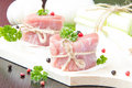 Fresh fillet of raw meat tied with twine on wooden desk with pep spices and herbs Stock Photography