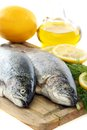 Fresh fish on board close up with dill and lemon a white background Stock Photo