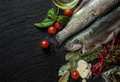 Fresh fish with spices, basil and cherry tomatoes Royalty Free Stock Photo