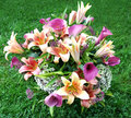 Fresh flower arrangement beautiful bouquet in the grassl Royalty Free Stock Photo