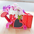 Fresh flowers and a little present colorful wrapped in dotted paper Stock Photography