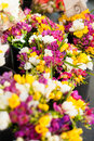 Fresh flowers at the market yellow white and purple flower bouquets Stock Photo