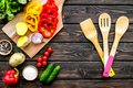 Fresh food ingredients for vegetarian kitchen on wooden background top view