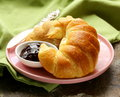 Fresh French croissant with jam Royalty Free Stock Photo