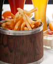 Fresh french fries on a bucket Royalty Free Stock Photos