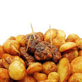 Fresh fried new potaoes and traditional mici Royalty Free Stock Photo