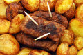 Fresh fried new potaoes and traditional mici Royalty Free Stock Images